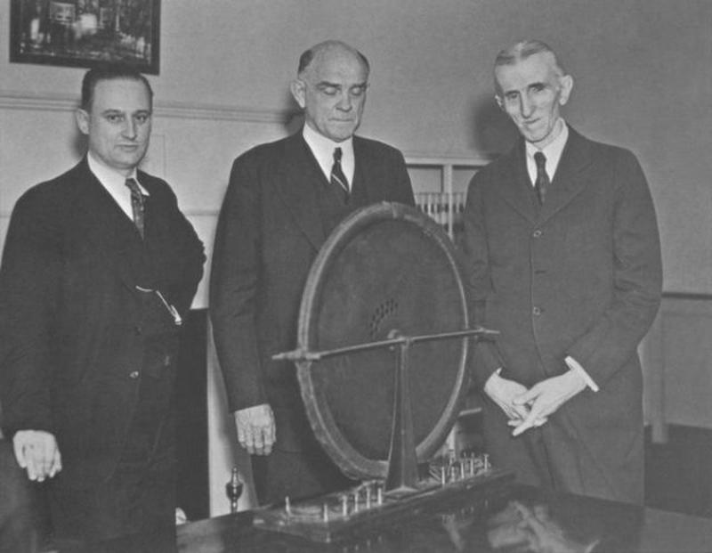 A photograph of John T. Morris, Victor Beam and Nikola Tesla.