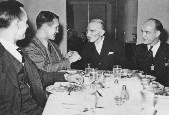 Photograph of Nikola Tesla during a dinner event.