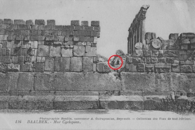 A stunning view of the massive, 1,200-ton block of stone at Baalbek, compared to two people sitting above it.