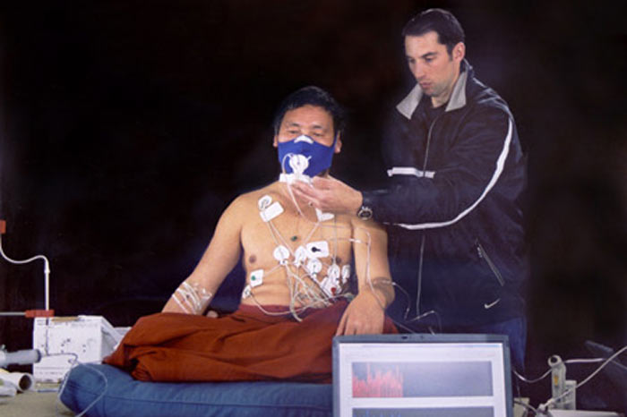 A Buddhist monk has his vital signs measured as he prepares to enter an advanced state of meditation in Normandy, France. During meditation, the monk's body produces enough heat to dry cold, wet sheets put over his shoulders in a frigid room Image Credit: Herbert Benson.