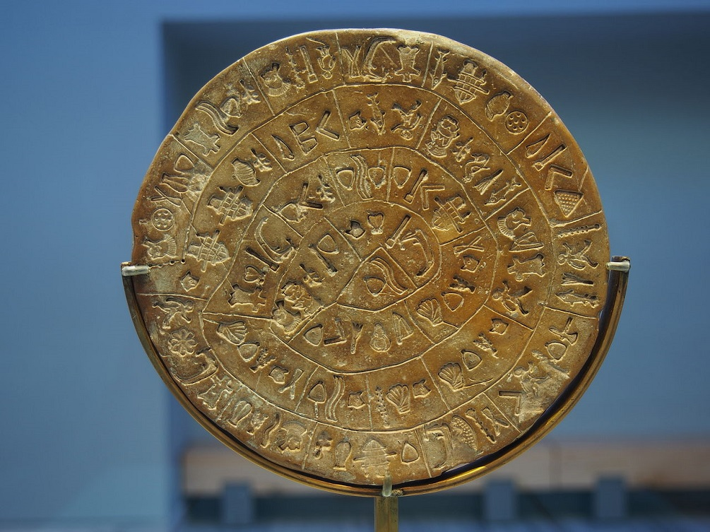 The side B of the disc of Phaistos, as displayed in the Archaeological Museum of Heraklion after the 2014 renovation. Image Credit: Wikimedia Commons.