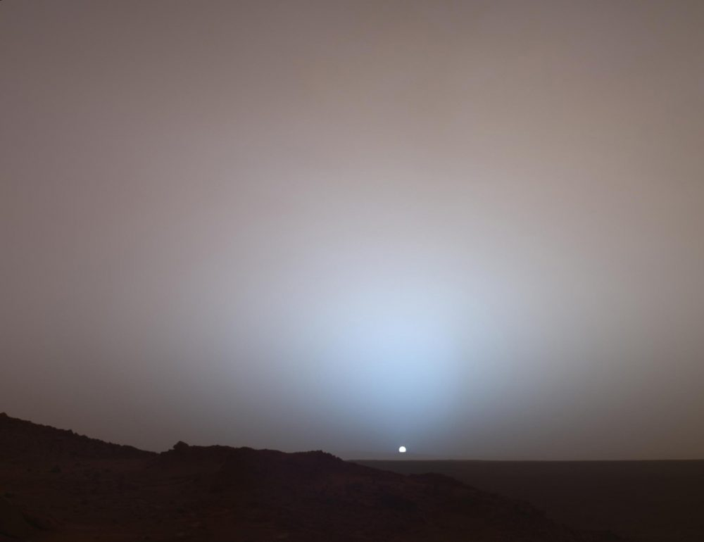 On May 19th, 2005, NASA's Mars Exploration Rover Spirit captured this stunning view as the Sun sank below the rim of Gusev crater on Mars. Image Credit: NASA/JPL/Texas A&M/Cornell.