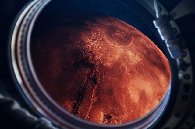 An artists illustration of a spacecraft visiting Mars. Shutterstock.