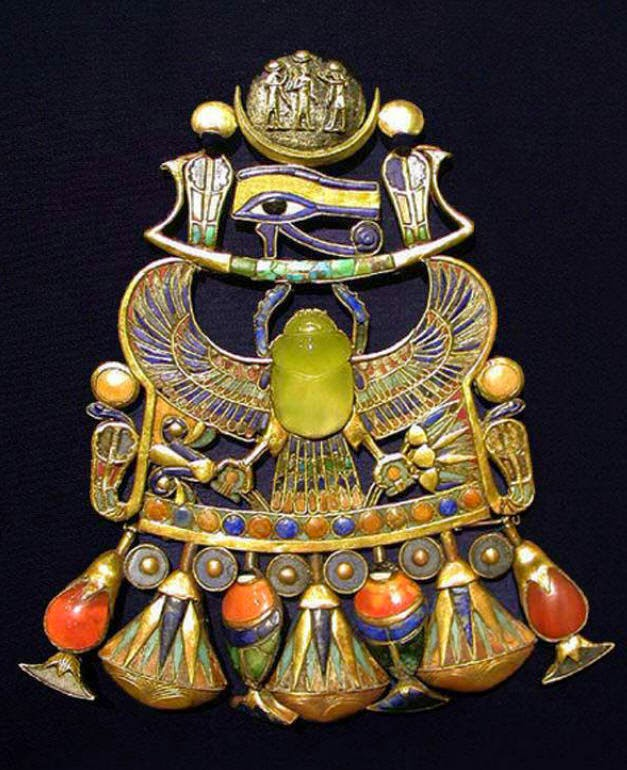 Pectoral with a winged scarab from King Tutankhamun's collection. Image Credit: Pinterest.