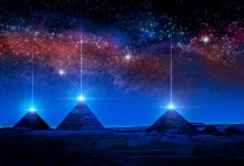 An artists illustration of pyramids with a glowing pyramidion. Shutterstock.