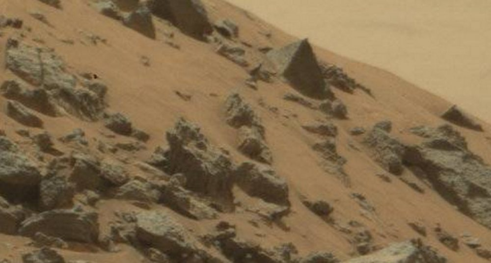 Ummm... Is that a pyramid on Mars? Not really, its just an oddly shaped rock. We can thank wind erosion for that.