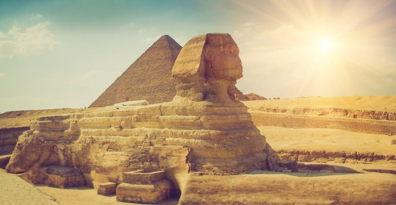 An image of the Sphinx with the pyramid in the background.