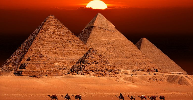 The Pyramids at Giza and the sunset. Shutterstock.