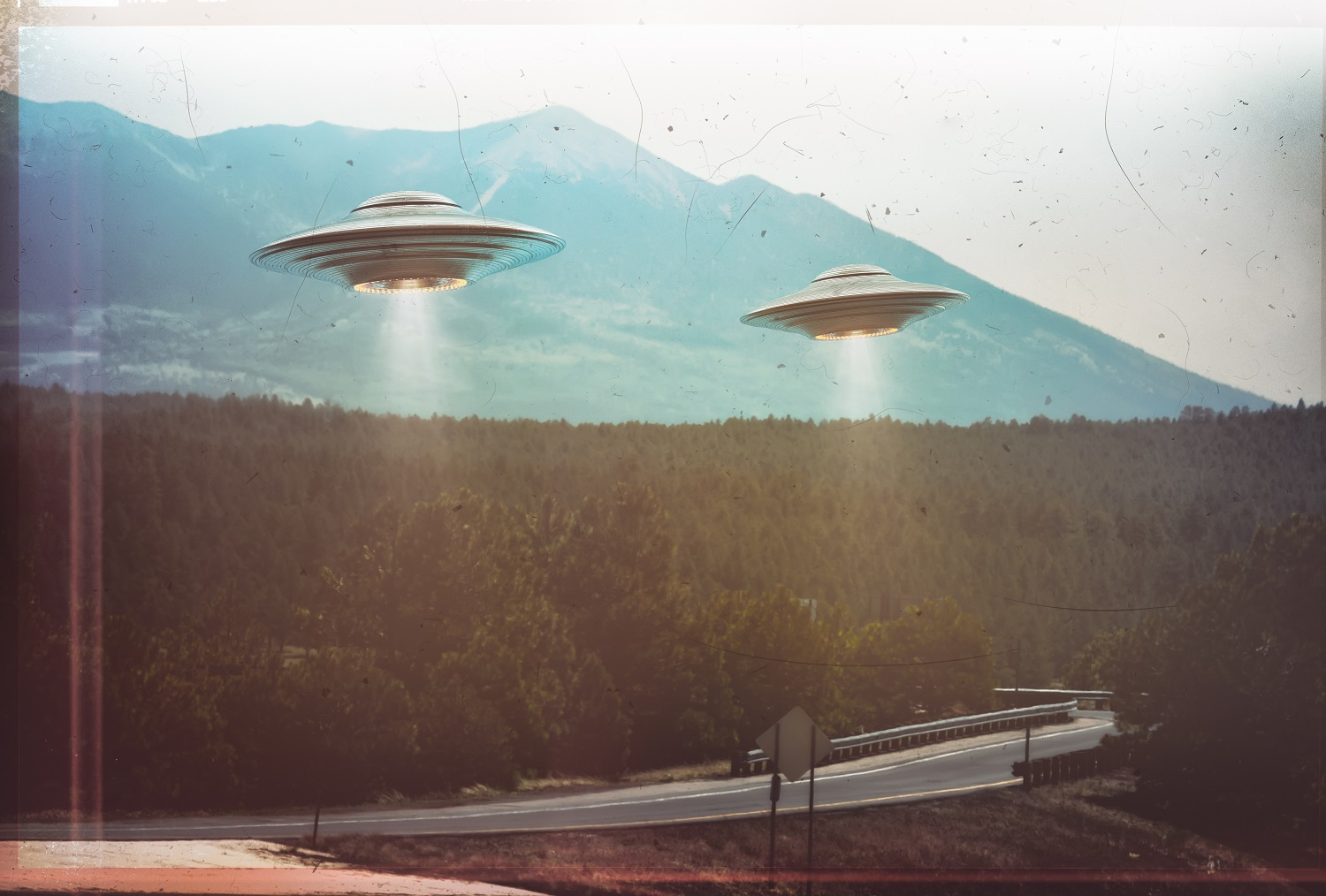 Two UFOs flying in the sky. Shutterstock.