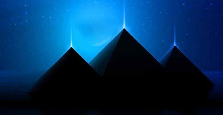 An artists illustration of three pyramids that shine. Shutterstock.