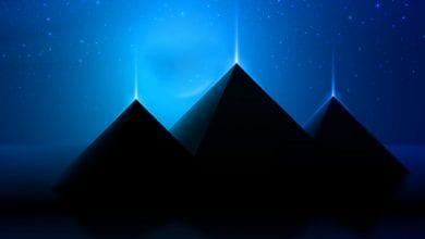 An artists illustration of three pyramids that shine. Shutterstock.