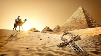 Camel rider, the Pyramids, and an ancient treasure in the sand. Shutterstock.