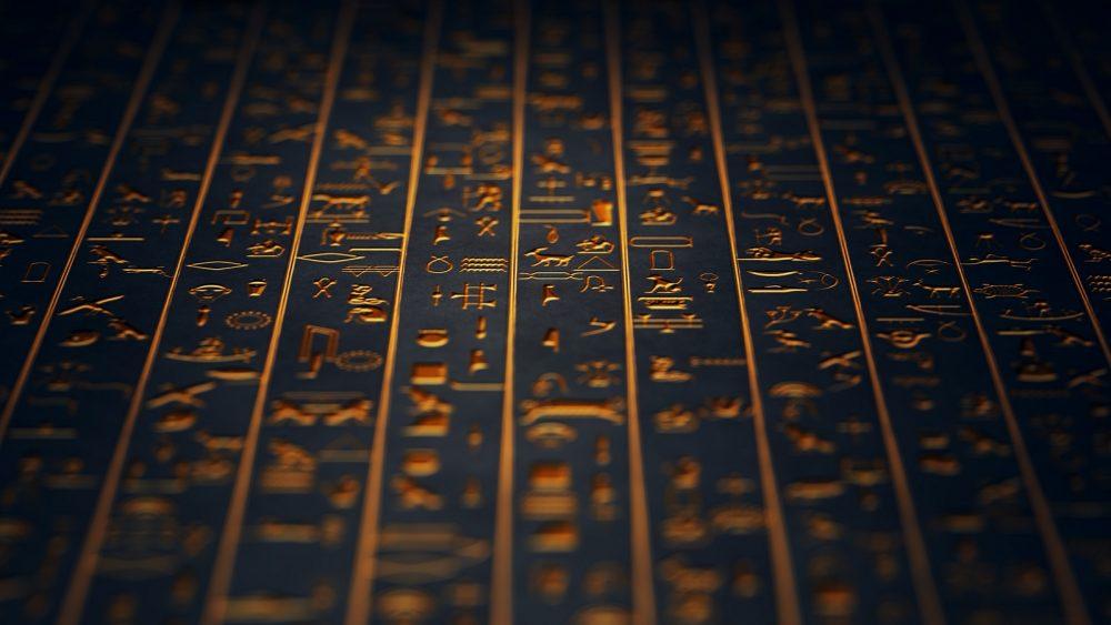 Golden Ancient Egyptian Hieroglyphs. Shutterstock.