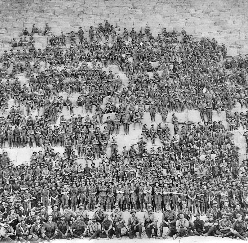 Group photo of Australian 11th Battalion soldiers on the Great Pyramid in 1915. Wikimedia Commons.