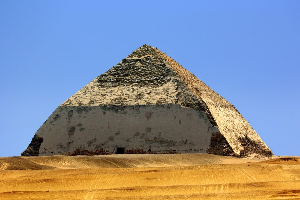 The Bent Pyramid, also known as the False, or Rhomboidal Pyramid because of it changed angle slope, commissioned by Pharaoh Sneferu. Shutterstock.