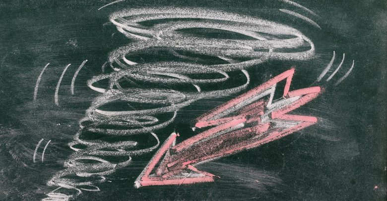 Chalkboard Drawing of a Tornado and an arrow. Shutterstock.