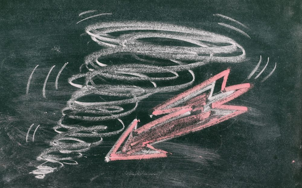 Chalkboard Drawing of a Tornado and an arrow. Shutterstock.
