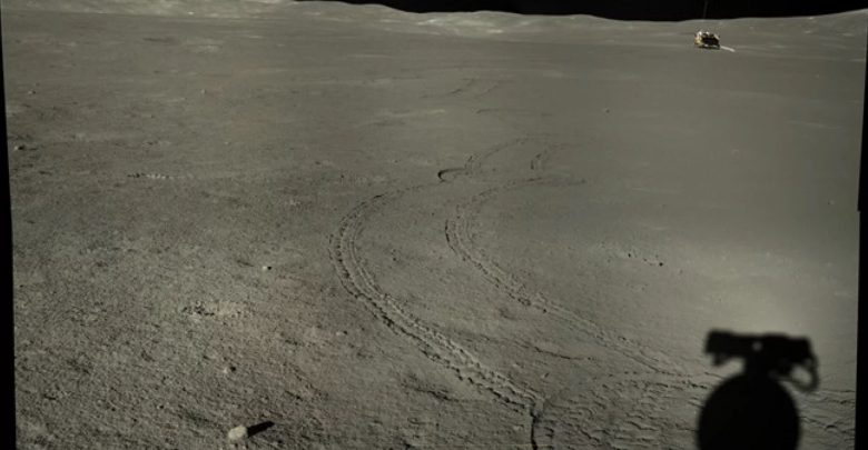 A composite image showing the shadow of the Yutu-2 rover, roving tracks, and the Chang'e 4 lander. The photograph was snapped during lunar day 7. Image Credit: CNSA / CLEP.