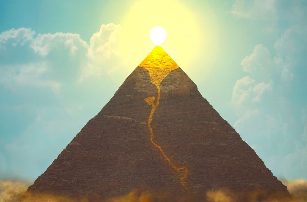 Artists rendering of a Pyramid and a glowing top. Shutterstock.