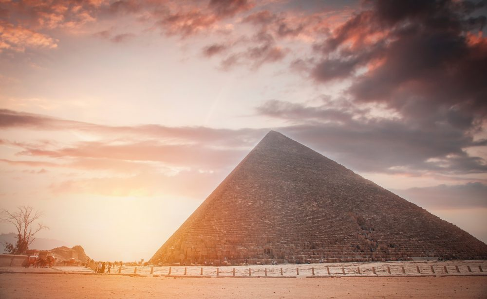 Great Pyramid of Giza with the sun in the background. Shutterstock.