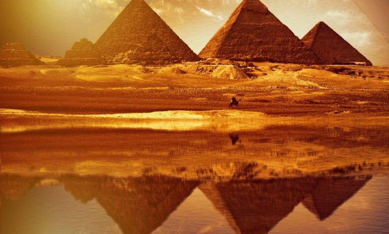 The reflection of the pyramids at Giza, as above so below. Shutterstock.