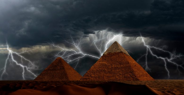 Pyramids at Giza and lightning. Shutterstock.