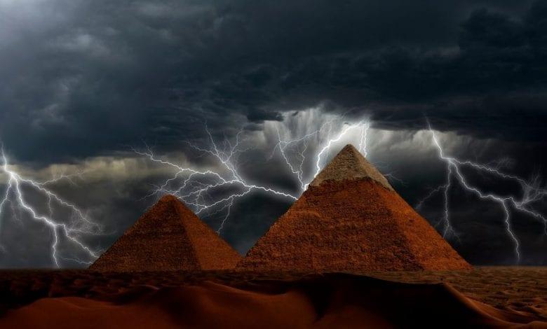 Pyramids at Giza and lightning. Shutterstock.