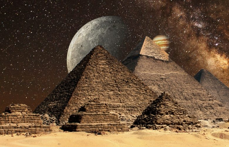 Artists rendering of the Pyramids at Giza with Jupiter and the Moon in the background. Shutterstock.