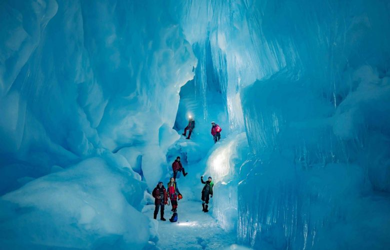 Explorers from the 24th Ukrainian Antarctic Expedition standing inside the subterranean world. Image Credit: Press Service of the Ministry of Education and Science of Ukraine.