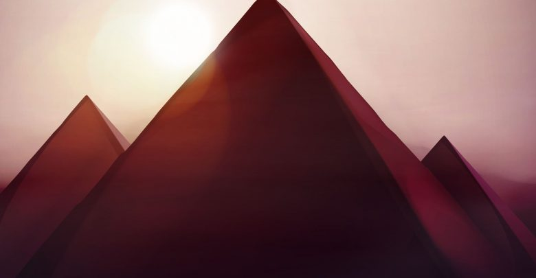 Artists rendering of pyramids and the sun. Shutterstock.