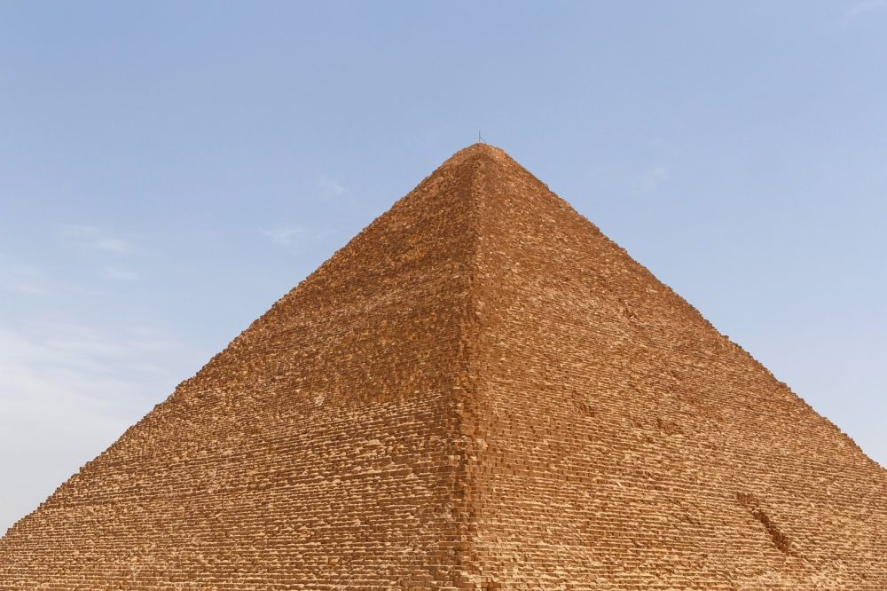 "At completion, the Great Pyramid was surfaced with white ""casing stones."" Shutterstock."