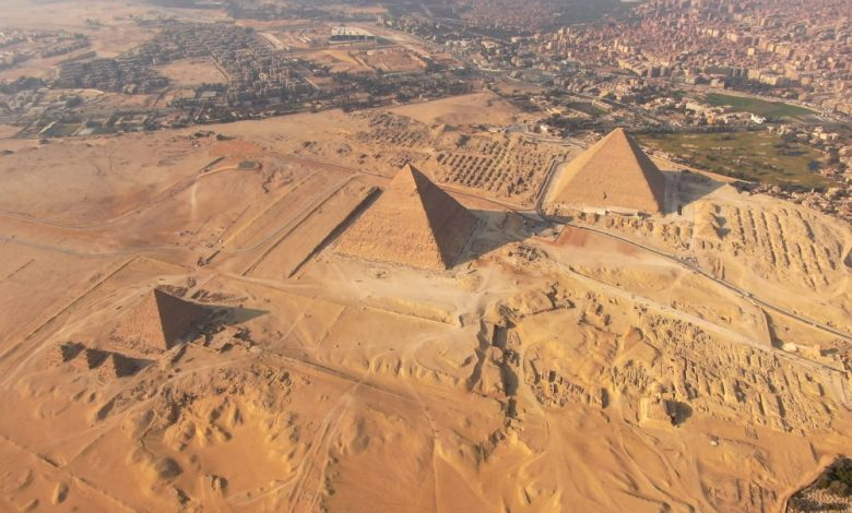 A stunning aerial view of the three main pyramids at the Giza plateau. Shutterstock.