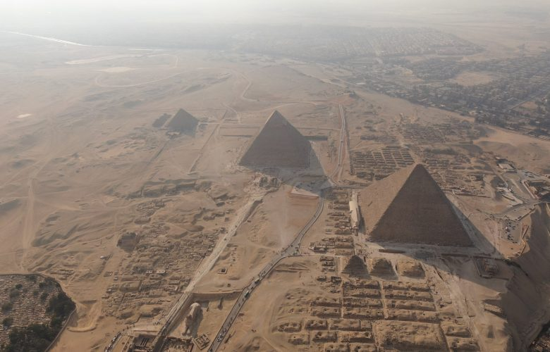 The Giza plateau with its three predominant pyramids. Shutterstock.