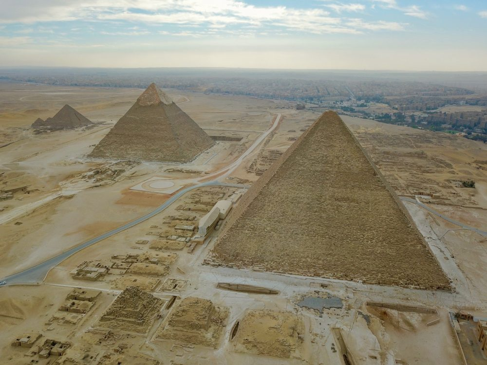 Incredible view of the Great Pyramid from the air, and its accompanying pyramids. Shutterstock.