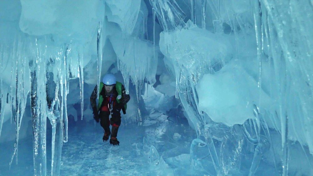 An Ukrainian explorer walking through the cave. Image Credit: Image Credit: Press Service of the Ministry of Education and Science of Ukraine.
