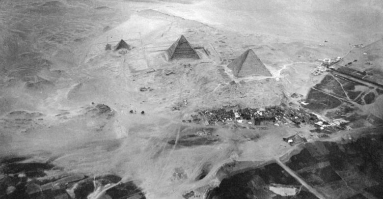 Pyramids of Giza, Egypt. From left to right: Menkaure, Khafre, Khufu. Photographed from a balloon from about 600 meters above ground. Image Credit: Wikimedia Commons.