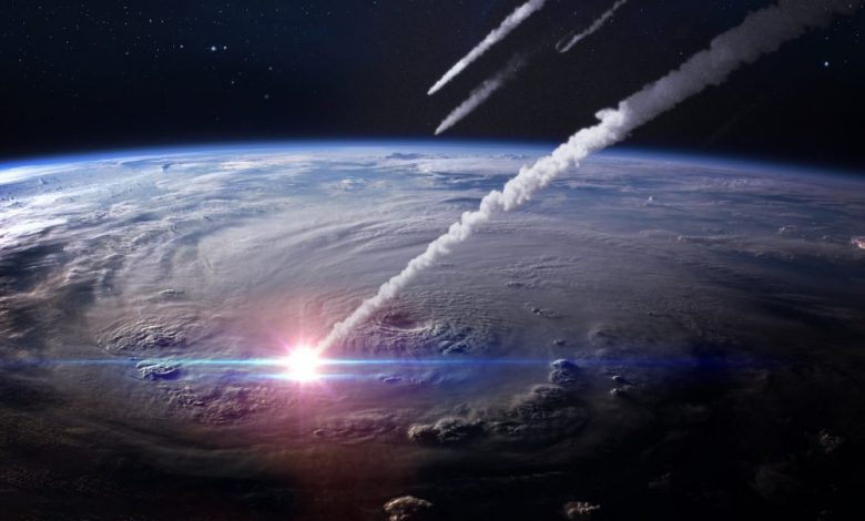 An illustration showing asteroids impacting Earth. Shutterstock.