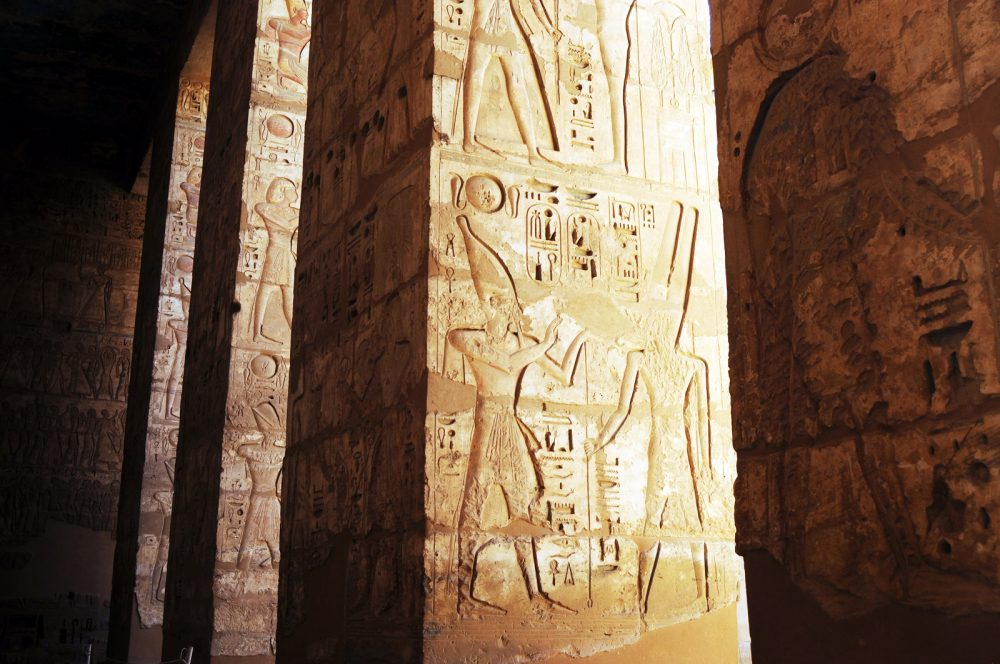 Inscriptions on the walls of an ancient Egyptian Temple. Shutterstock.