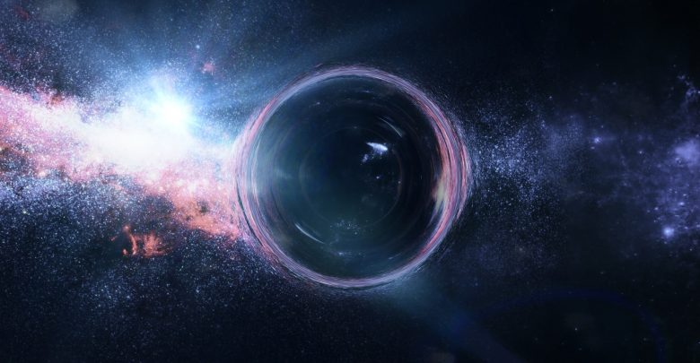 An artist's rendering of a black hole with gravitational lens effect in front of bright stars. Shutterstock.