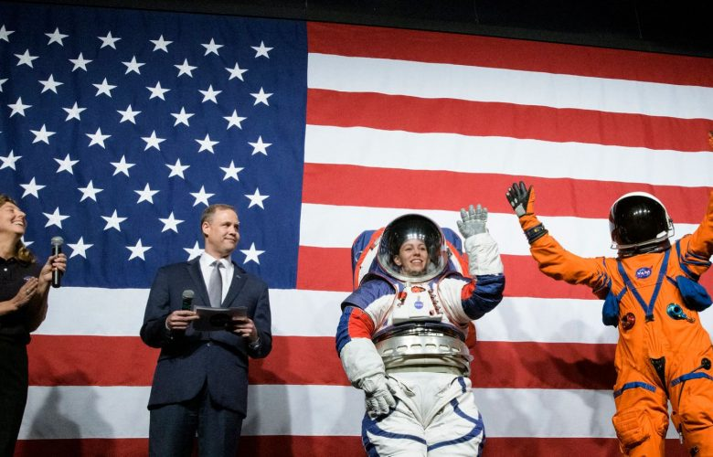Two of the new spacesuits presented by NASA for the 2024 moon landing mission are seen in this image. Image Credit: NASA / NASA HQ Photo / Flickr.