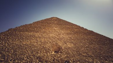 A view of the Great Pyramid of Giza, its entrance and people accessing it. Shutterstock.