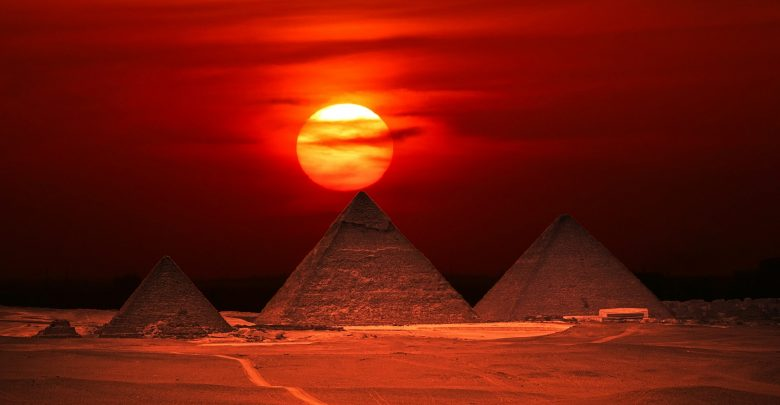 The Pyramids at Giza at sunset. Shutterstock.