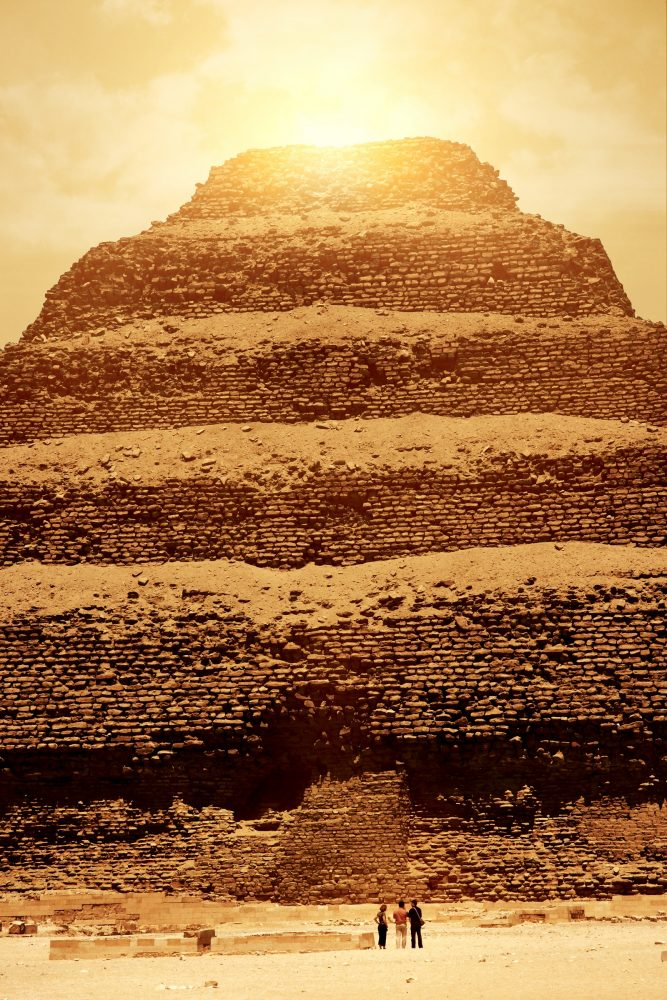 Tourists standing in front of Djoser's Step Pyramid. Shutterstock.