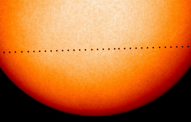 This composite image of observations by NASA and the ESA's Solar and Heliospheric Observatory shows the path of Mercury during its November 2006 transit. Image Credit: NASA.