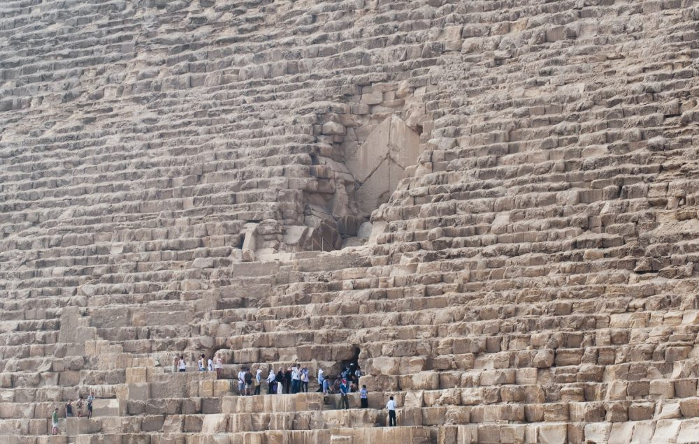 A group of people climbing the Great Pyramid. Shutterstock.
