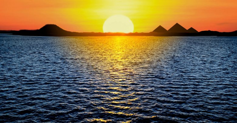 An image of the Nile, sunset and artists rendering of pyramids. Shutterstock.