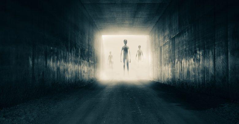 Artists rendering of aliens entering a room. Shutterstock.