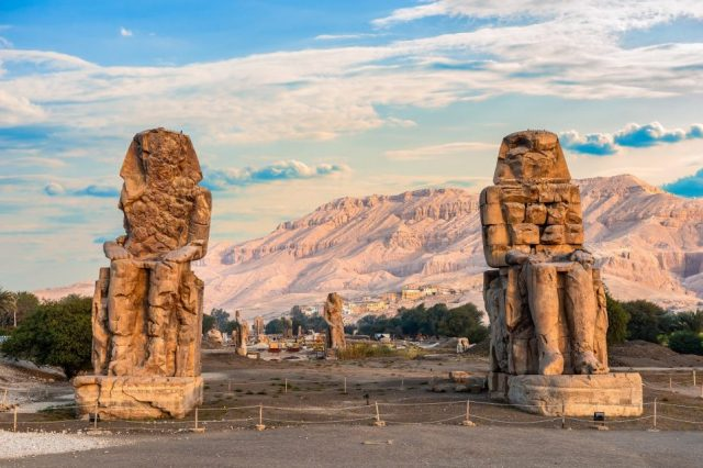 An image of the Colossi of Memnon. Shutterstock.