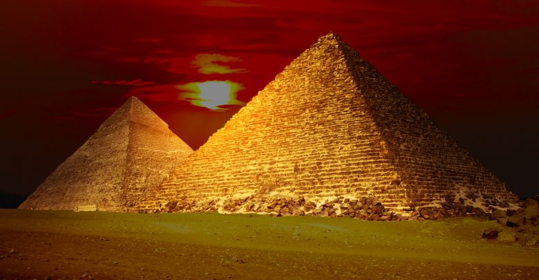 An image of the Egyptian pyramids and the sunset in the background. Shutterstock.