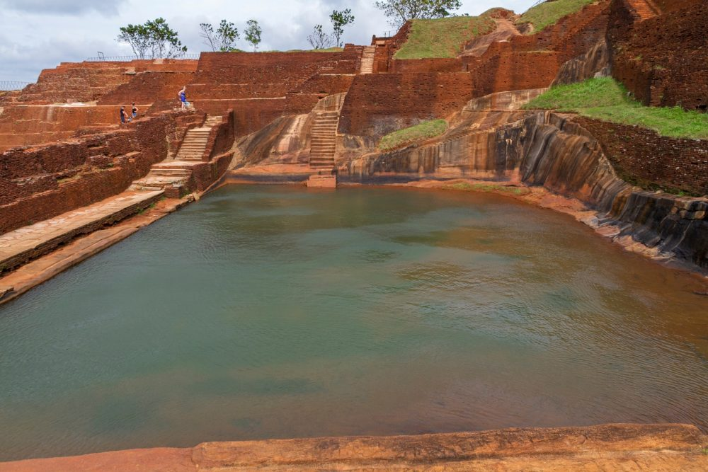 An image of the top of the Sigiriya rock fortress and its water gardens. Shutterstock.